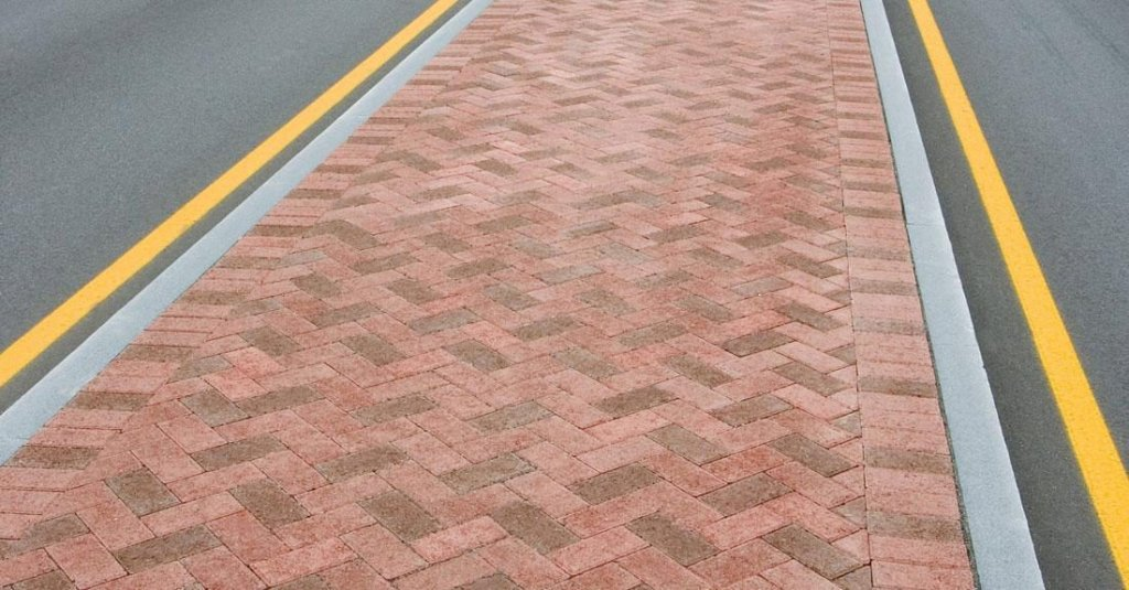 Strip of Unilock Hollandstone pavers in the middle of the road