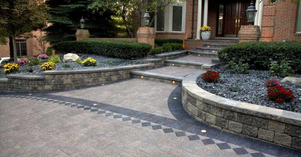 Light and dark style pattern of Unilock pavers for stairs and walls