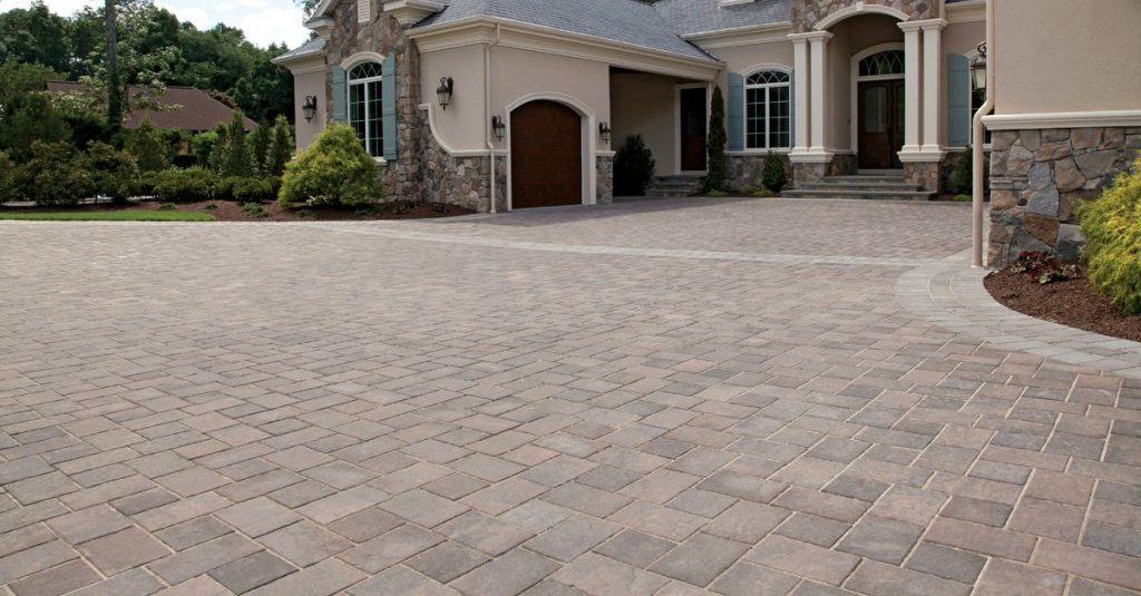 Unilock Transition pavers used for driveway leading up to house with pillars