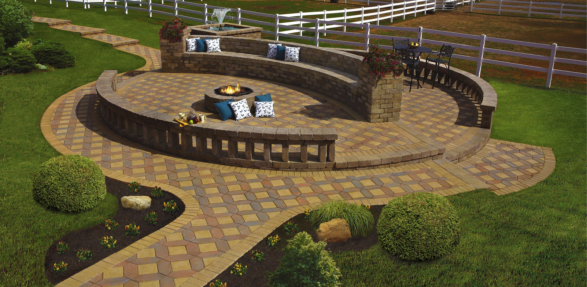 Circular backyard patio with wall and walkway made from Excalibur paving stones