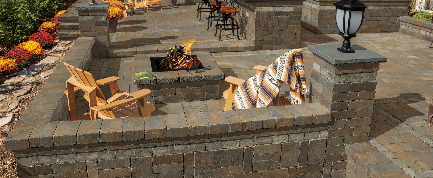 Outdoor living space with square fire pit, wall systems and patio