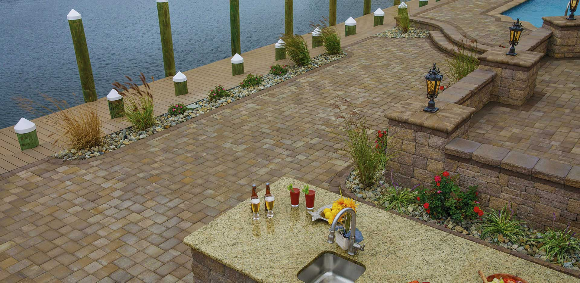 Outdoor living area along the water made of Roundtable pavers for walkway