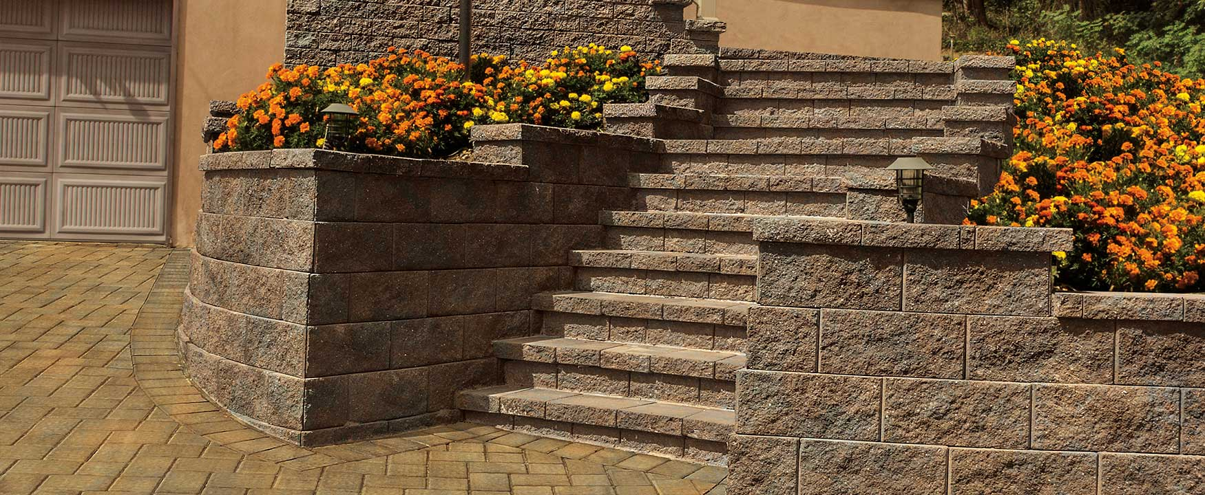 Wall and steps made with Cambridge Wall Systems concrete pavers