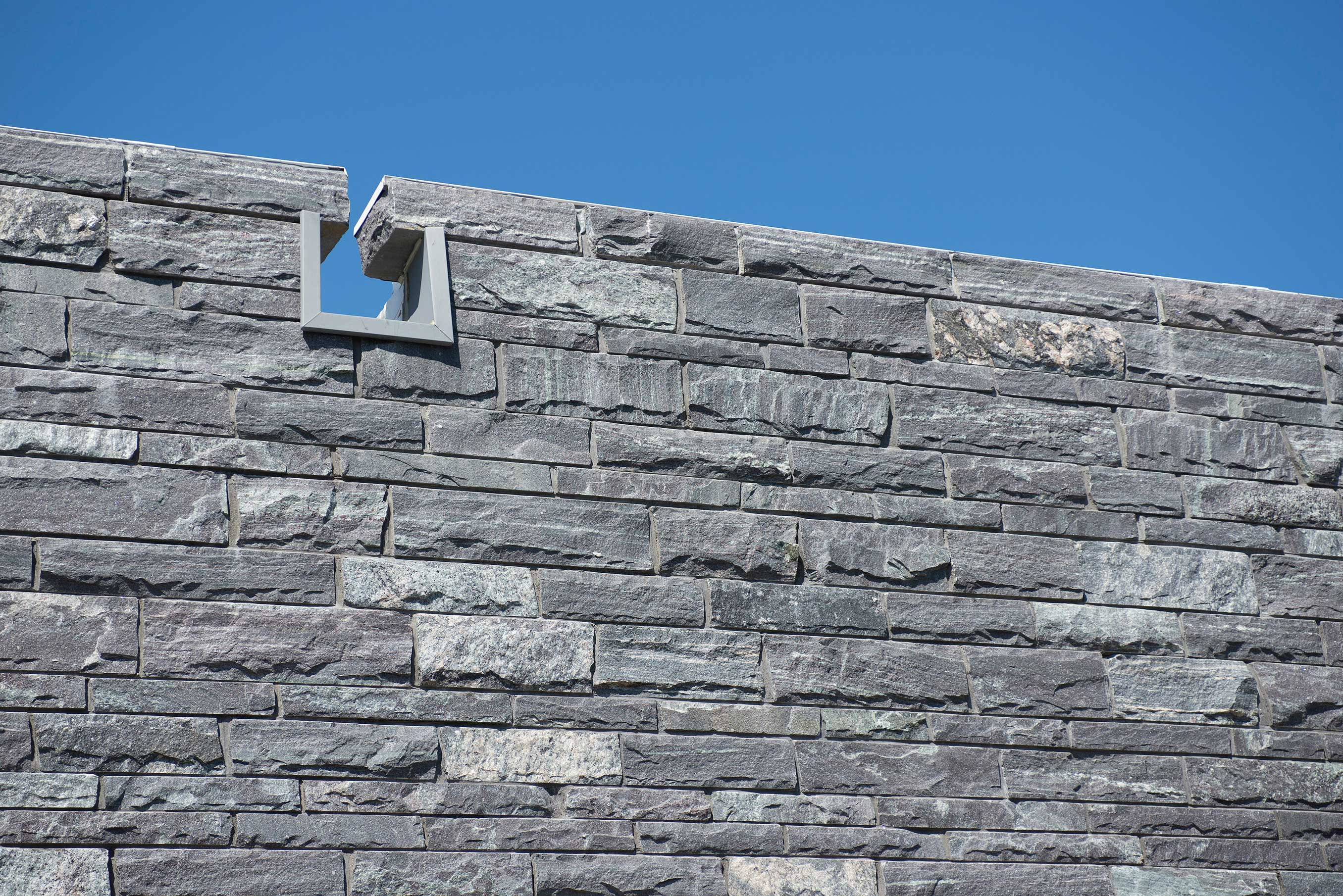 Gray granite stones in large wall