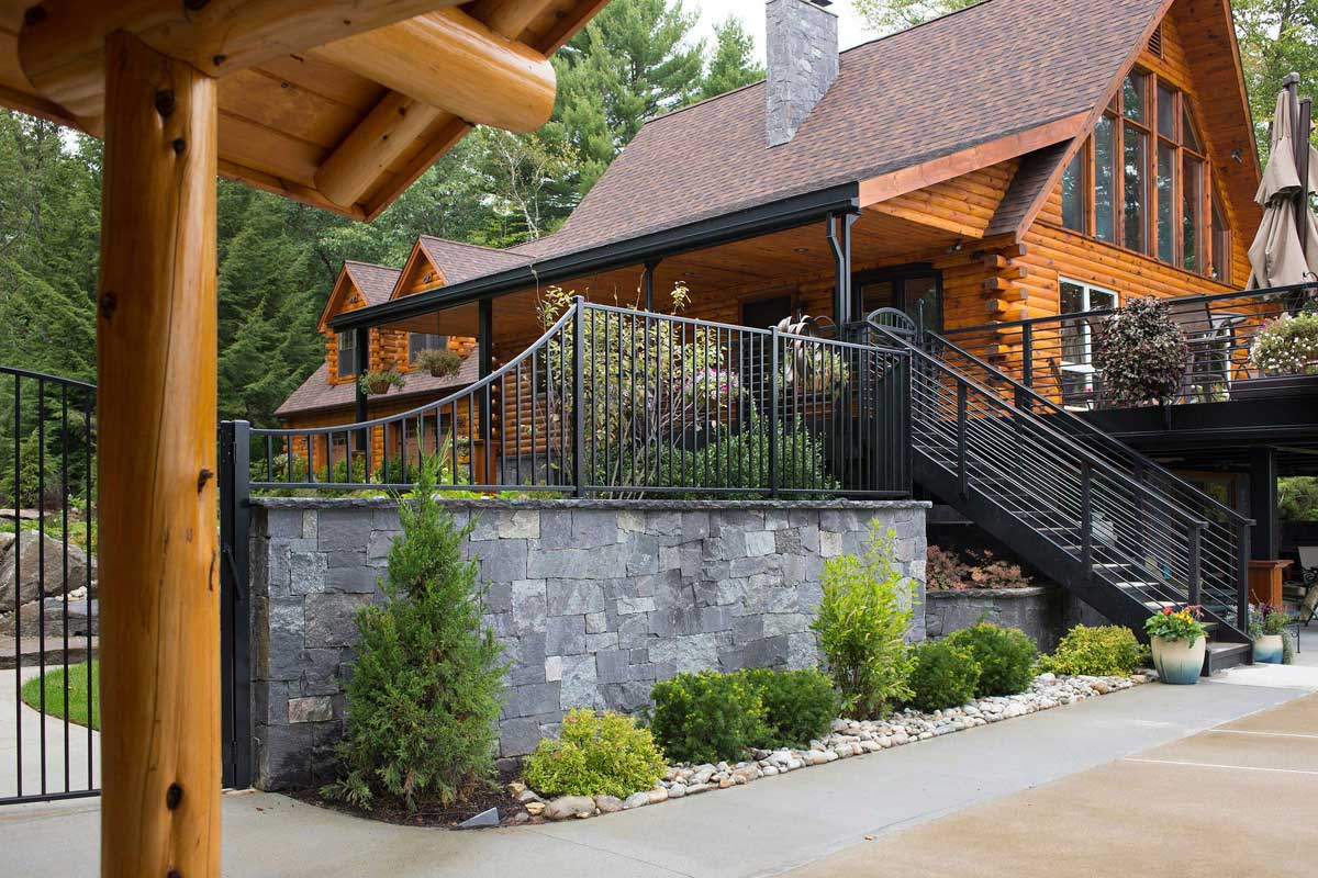 Log cabin home with granite stone wall