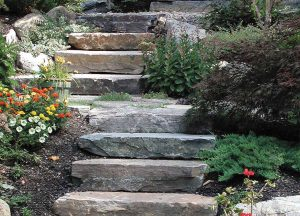 Stone slabs used for outdoor steps in landscaped garden