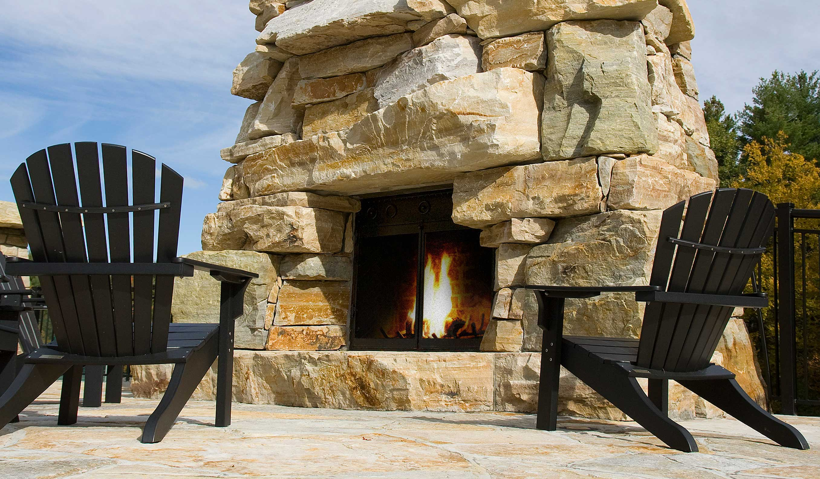 Large stone risers used to build an exterior fire place