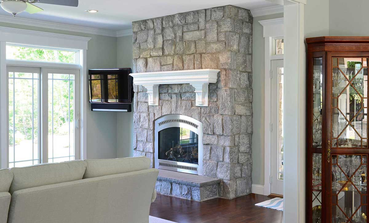 Fireplace in living area made of Wood Creek granite stone