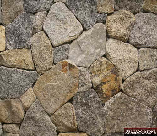 Mosaic shaped stones in wall