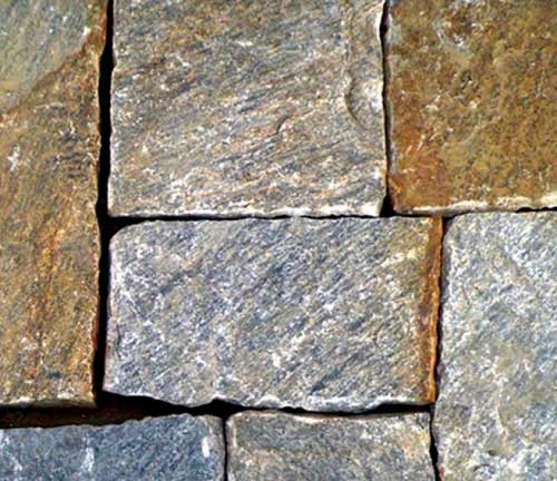 Thick square and rectangular stones in wall