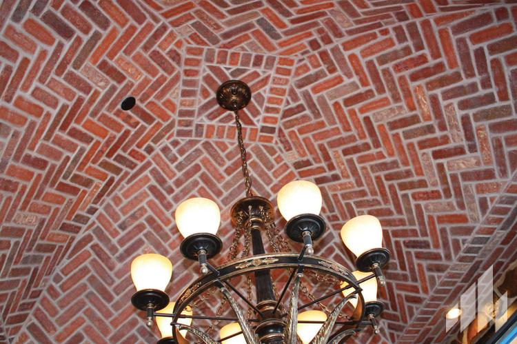 Manufactured veneers brick ceiling with chandelier hanging