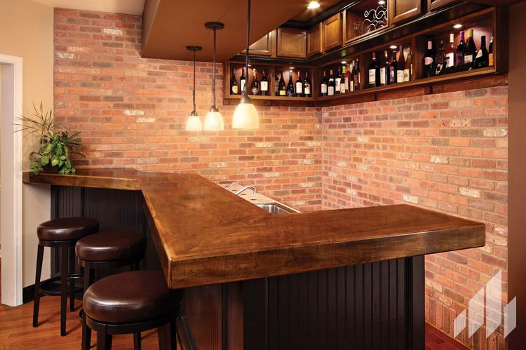 Manufactured veneers brick wall behind wet bar