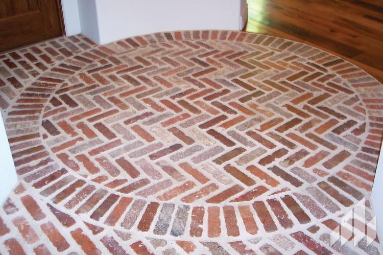 Manufactured veneers circular brick floor