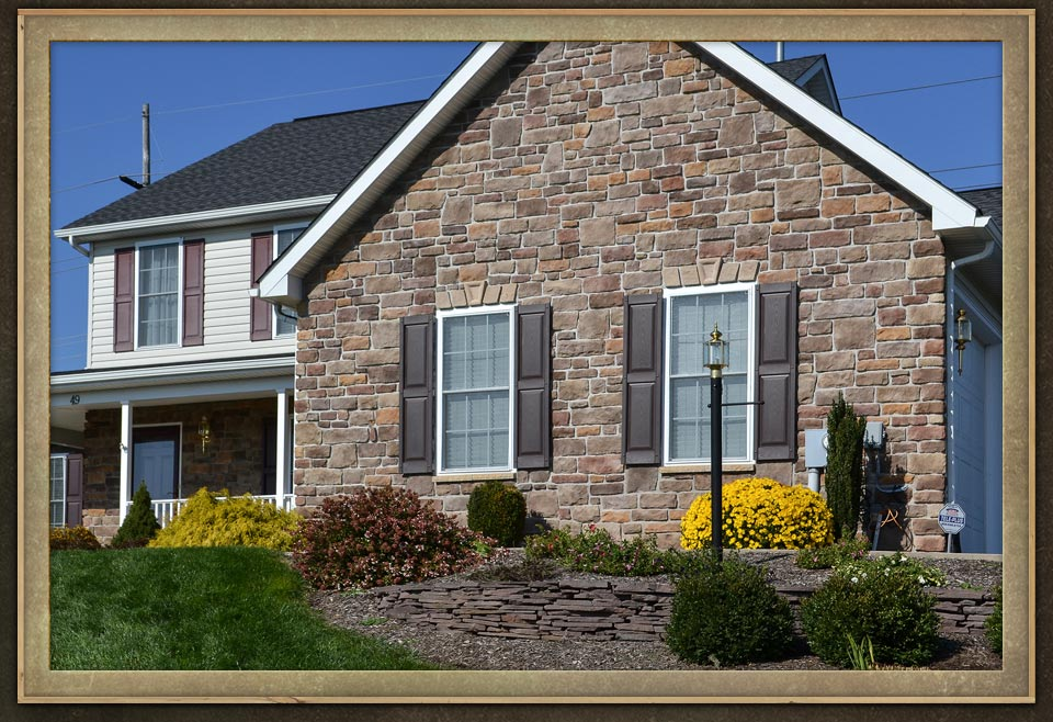 Home exterior wall with stones of different thickness and sizes