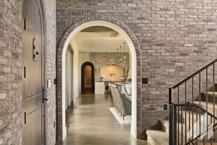 Manufactured veneers brick wall in home entrance
