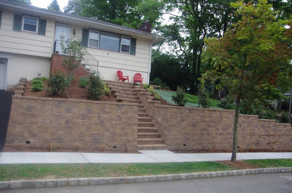 Retaining wall and stairs lead to front of house