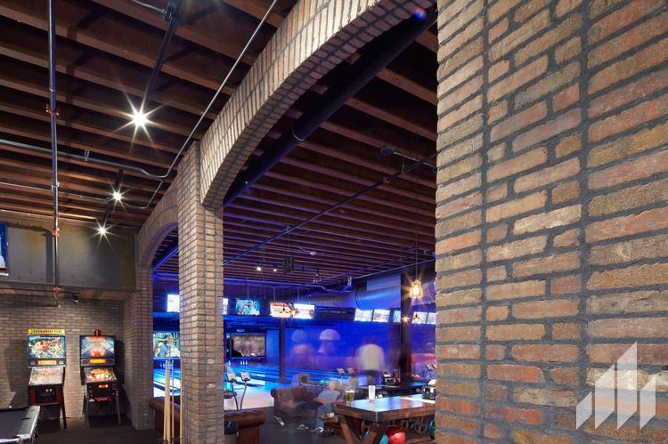 Manufactured veneers brick wall in commercial game room