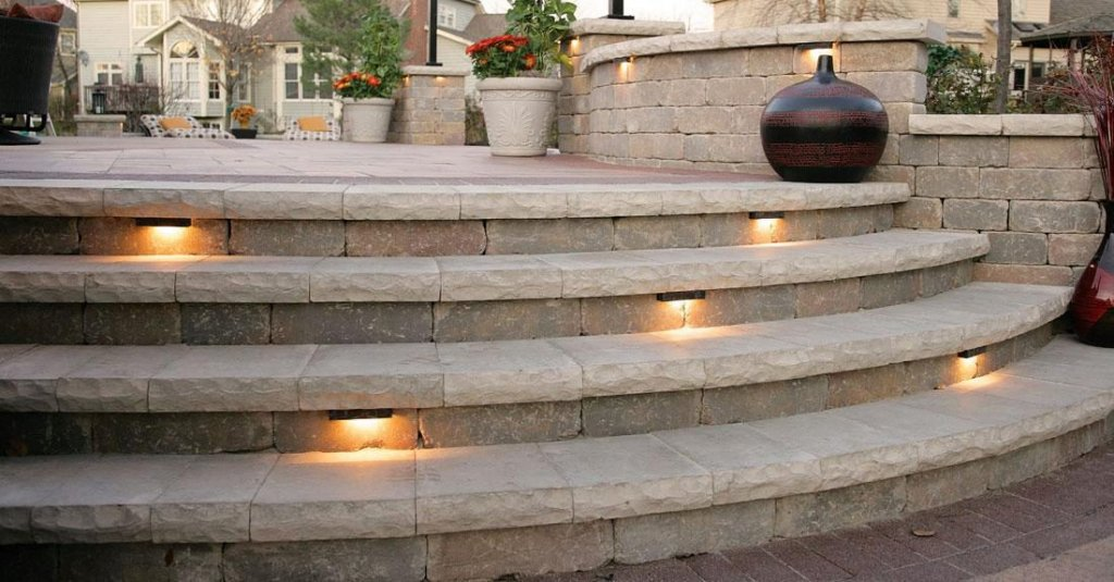 Stairs with lighting built with Unilock Ledgestone Wall System