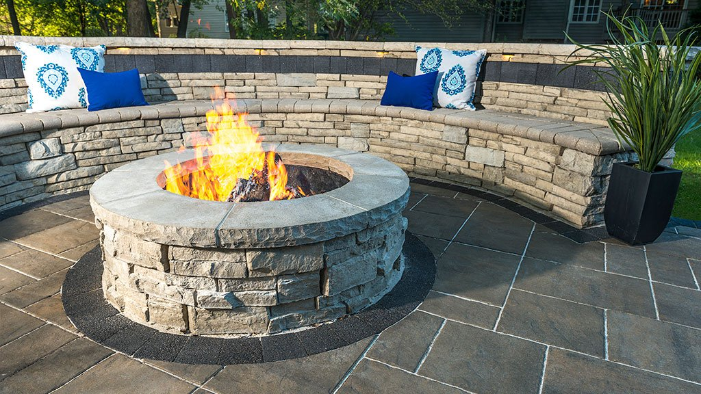 Circular fire pit with with fire burning inside
