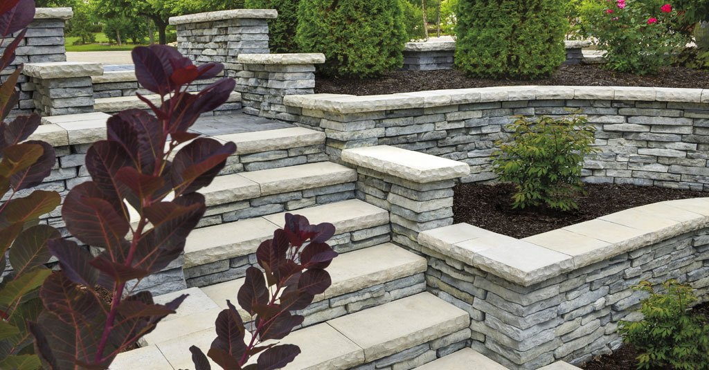 Retaining walls and steps made from Unilock Rivercrest Wall Systems