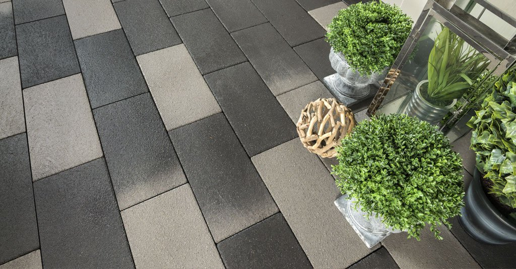 Uniform rectangular pavers in two colors dark and light gray
