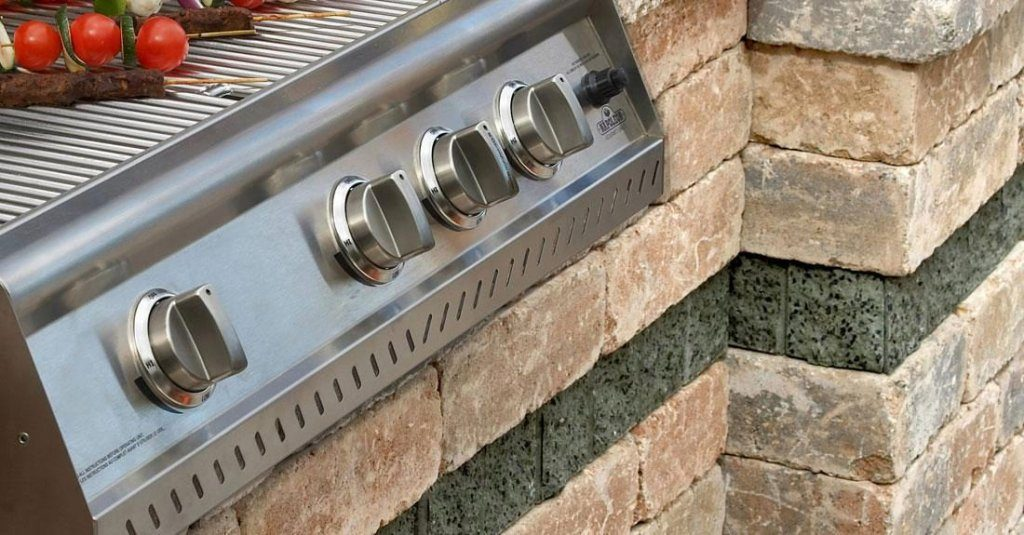 Closeup of barbecue controls built into wall system
