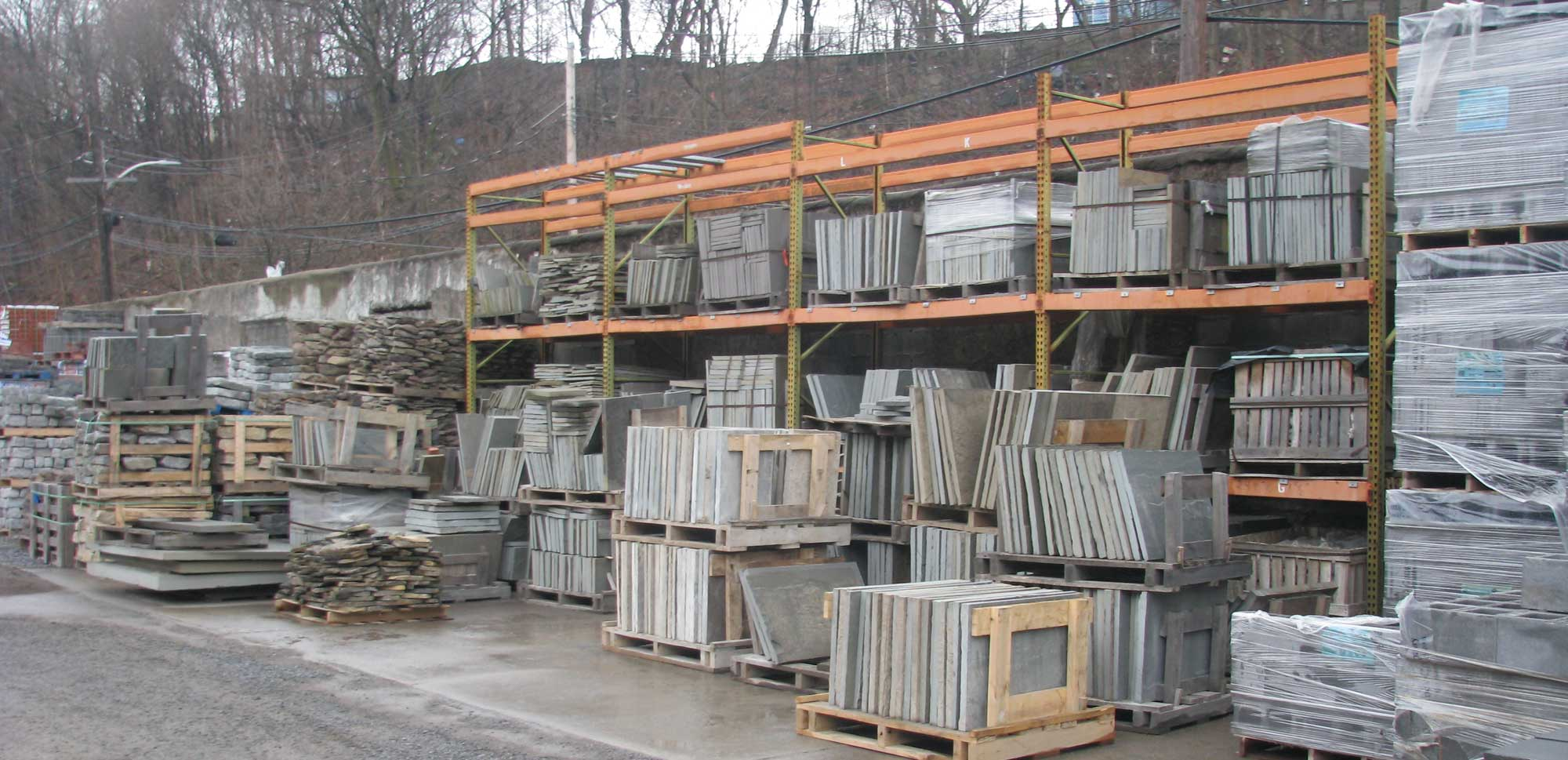 Home Mason Peekskill yard with racks filled with stone products in pallets