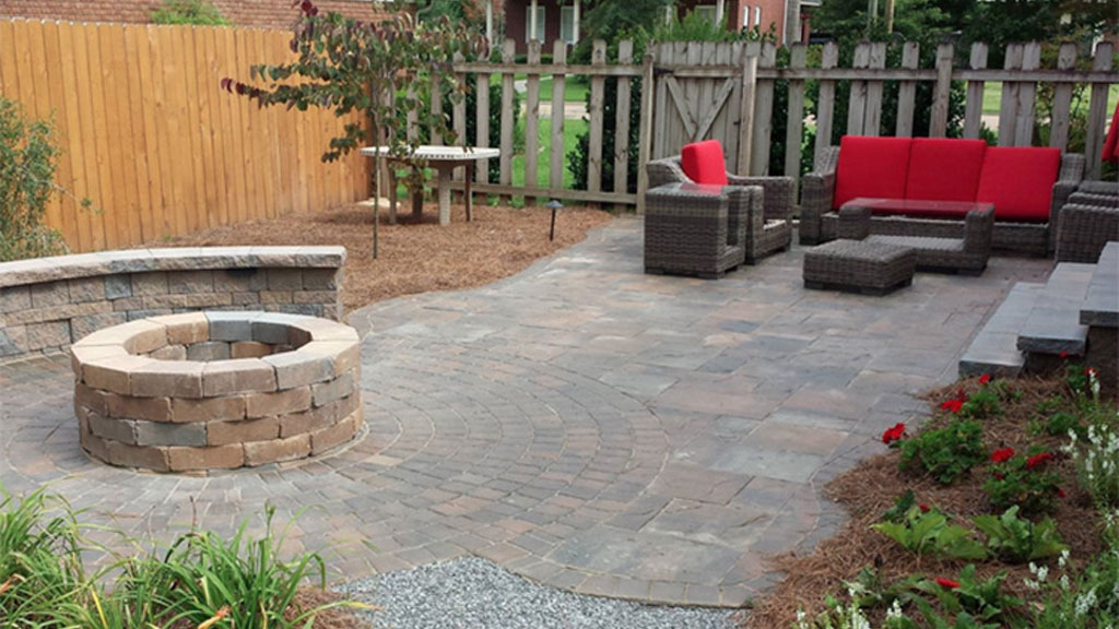 Circular Fire Pit In An Outdoor Patio Made Of Stone Products