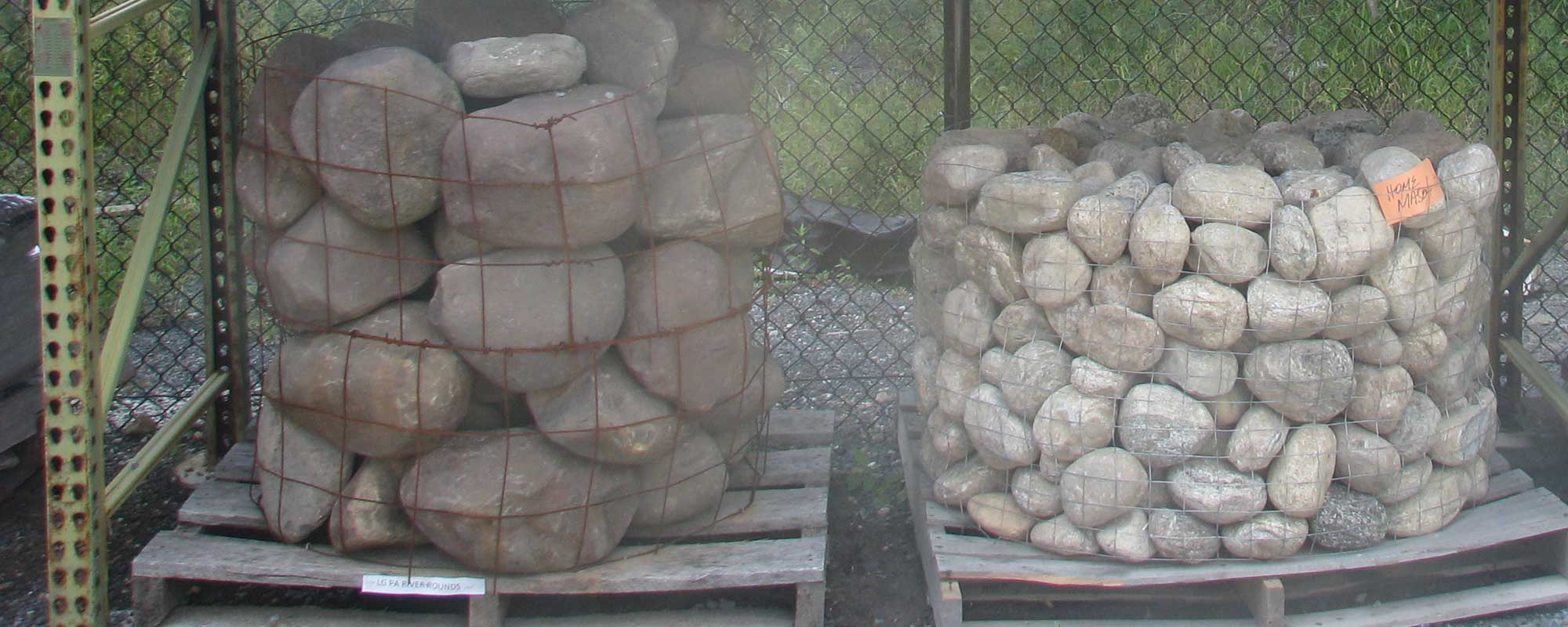 Two pallets of River Rounds in small and large sizes