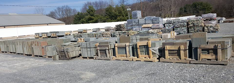 Pallets of stone products in Hopewell Junction yard.